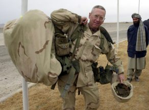 Brig. Gen. James Mattis carries his packs into the Kandahar International Airport in Kandahar, Afghanistan where he will set up operations after arriving Friday, Dec. 14, 2001. The U.S. Marines have taken control of the airfield and have the mission of making it ready to receive fixed wing aircraft. (AP Photo/Dave Martin, Pool)